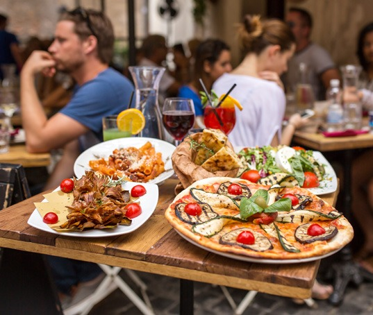 Rome, Italy - September 11, 2015: Unidentified people eating tra